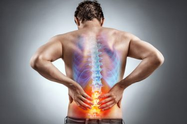 Lower back pain is a common sciatica symptom.